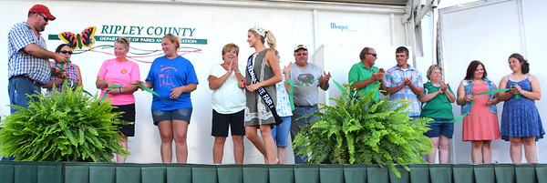 Debbie Blank | The Herald-Tribune<br /> Miss Indiana State Fair Tate Fritchley (center) cut the ribbon to open the Ripley County 4-H Fair as the fair board watches.