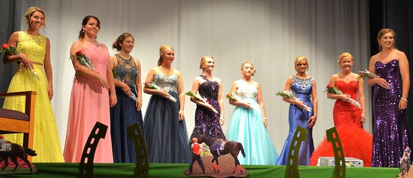 Debbie Blank | The Herald-Tribune<br /> Modeling their evening gowns are (from left) Carah Beck, Kendra Franklin, Rebecca Eckstein, Jessica Raver, Cheyenne Kern, Bridget Swinney, Hanna Speer, Andrea Grossman and Sarah Pitts.