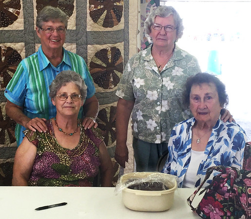 Submitted photo<br /> In addition to organizing open exhibits for adults, Ripley County Homemakers will be raising money with bake sales at the 4-H fair. Recently (back row from left) Helen Mobrley, Shirley Grubbs; (front row) Mary Ann Rodgers and Ruth Pickett were selling sweet items at the FARM Club show.