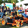 Debbie Blank | The Herald-Tribune<br /> Farm equipment attracted the attention of Jim Rennekamp (from left), Sunman, his son Jimmy, 15, and Theo Martini, 15, Sunman. The boys' favorite 4-H projects are welding and small engines, respectively.