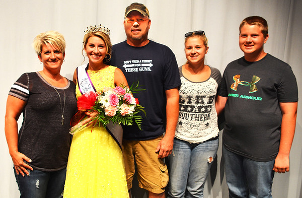 Debbie Blank | The Herald-Tribune<br /> Queen Carah Beck is congratulated by her Dillsboro family (from left): mom Angel; dad Doug; sister Caitlynn, 20; and brother Cale, 14.