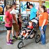 Debbie Blank | The Herald-Tribune<br /> Sheena (from left) and Darren Speer, Holton, with sons Abrahm, 6, and Carter (in stroller), 2, check out 4-H arts and crafts exhibits with friends Justin Beach, Holton, and Danielle Barth, Marysville.