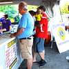 Debbie Blank | The Herald-Tribune<br /> Volunteer Mary Ann McCoy (left) waits on customers at the Osgood Lions Club food booth.