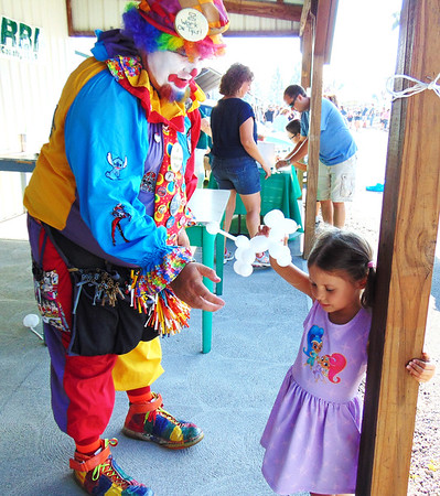 Diane Raver | The Herald-Tribune<br /> This young lady didn't know what to think of the clown.