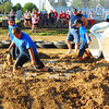 Diane Raver | The Herald-Tribune<br /> Youngsters participating in the Barnyard Olympics try to hurry through the mud.