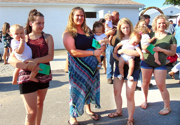 Diane Raver | The Herald-Tribune<br /> Youngsters and their mothers waited patiently for their turn in the baby contest.