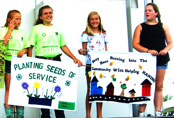 Debbie Blank | The Herald-Tribune<br /> The Busy Bees (right) took first place in the banner contest while the Faithful Workers captured second place during the opening ceremony.
