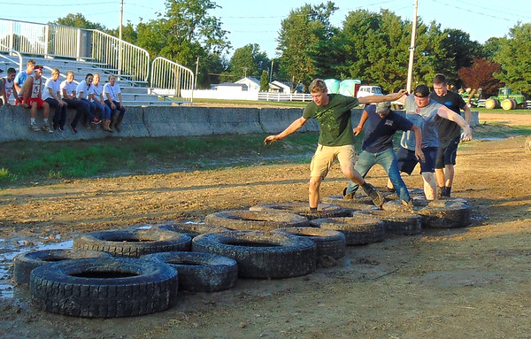 Diane Raver | The Herald-Tribune<br /> The King and the Merry Men team consisting of Keegan Moster (from left), Nathan Flaspohler, Levi Stenger and Ben Krieg won the age 18 and up division of the Barnyard Olympics. The event raised $1,572 for South Ripley FFA Memorial Scholarships.