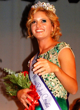 "Debbie Blank | The Herald-Tribune<br /> Hanna Speer takes her first walk on the Damm Theatre stage as Miss Ripley County. Of her new crown, the teen says, ""I did not expect it at all!"""