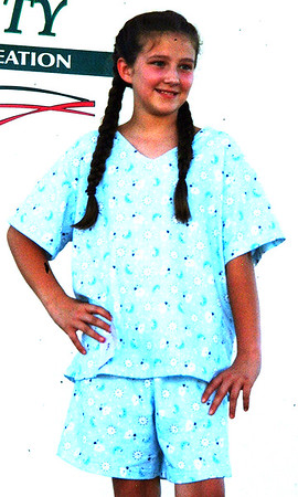 Debbie Blank | The Herald-Tribune<br /> St. Louis School sixth-grader Rhea Miller, a Napoleon 4-H Country Club member, made a pajama set for the sewing projects Junior Division.
