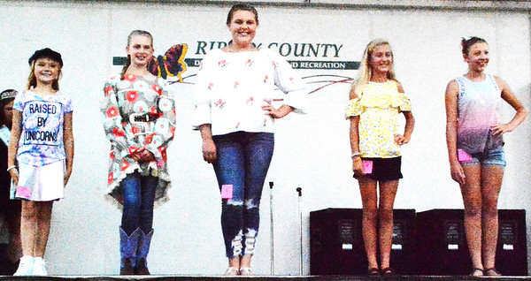 Debbie Blank | The Herald-Tribune<br /> Consumer clothing competitors were (from left) Ella Saylor (Beginner Reserve Grand Champion), Sophia Sullivan (Beginner Grand Champion), Olivia Neal (Intermediate Reserve Grand Champion), Tristan Rowlett (Intermediate Grand Champion) and Lydia Sarringhaus.