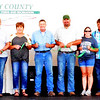 "Debbie Blank | The Herald-Tribune<br /> The Ripley County 4-H Corp. board members were introduced at the fair's grand opening July 22. Master of ceremonies Darren Engelking paid tribute to the late Brian Evans, a 10-year volunteer and dad who died May 23. ""His go-getting nature ... and hard work are going to be missed."""