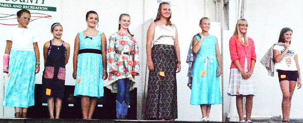 Debbie Blank | The Herald-Tribune<br /> The fashion revue included seamstresses in the Junior Division. They were (from left) Callie Comer, Felicity Brelage, Hailey Kunz, Sophia Sullivan (Grand Champion), Emilee Knueven, Julia Meyer, Kinsey Rohls and Rhea Miller (Reserve Grand Champion).