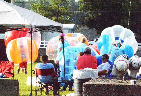 Debbie Blank | The Herald-Tribune<br /> JM Extreme Inflatable Ponies were the grandstands attraction Sunday evening at the Ripley County 4-H Fair. Participants tiptoed across the muddy oval to get into the grassy infield to try them out.