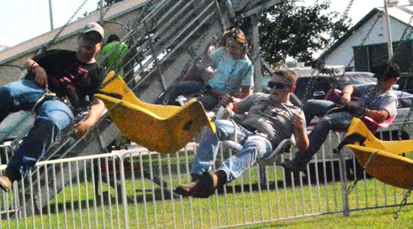 Will Fehlinger | The Herald-Tribune Youngsters ride The Swanger as part of Fun Time Carnival's wristband night July 24 at the Ripley County 4-H Fair.