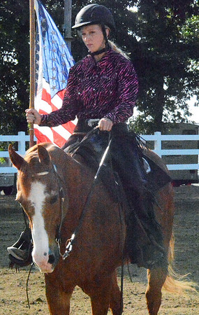 Will Fehlinger | The Herald-Tribune<br /> A patriotic salute was part of the Ripley County 4-H Horse & Pony Freestyle Show July 24 in Osgood.