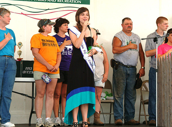 Staff photo by Bryan Helvie<br /> Getting started: Batesville High School student Brooke Hartman sang the National Anthem at the opening ceremonies for the Ripley County 4-H Fair on Sunday evening.