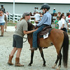Staff photo by Bryan Helvie<br /> A little advice: Participants are congratulated at the conclusion of their division in the horse and pony show at the Ripley County 4-H Fair on Sunday evening.