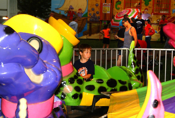 Christopher Aune   The Herald Tribune<br /> Alex Shupe, 4, son of Clarence and Betty Clarence Shupe, Batesville, was keeping an eye on his mother as he tried out rides at the Ripley County 4-H Fair.