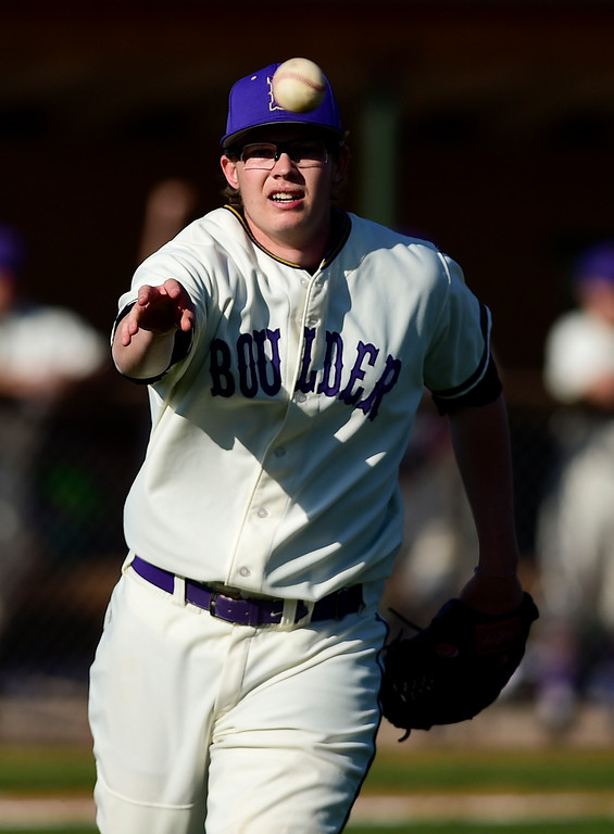 . BOULDER, CO - APRIL 25:Boulder High School\'s Dorsey Chatham (No. 21) throws to first in the game against Fairview High School at Scott Carpenter Park in Boulder on April 25, 2019. (Photo by Matthew Jonas/Staff Photographer)