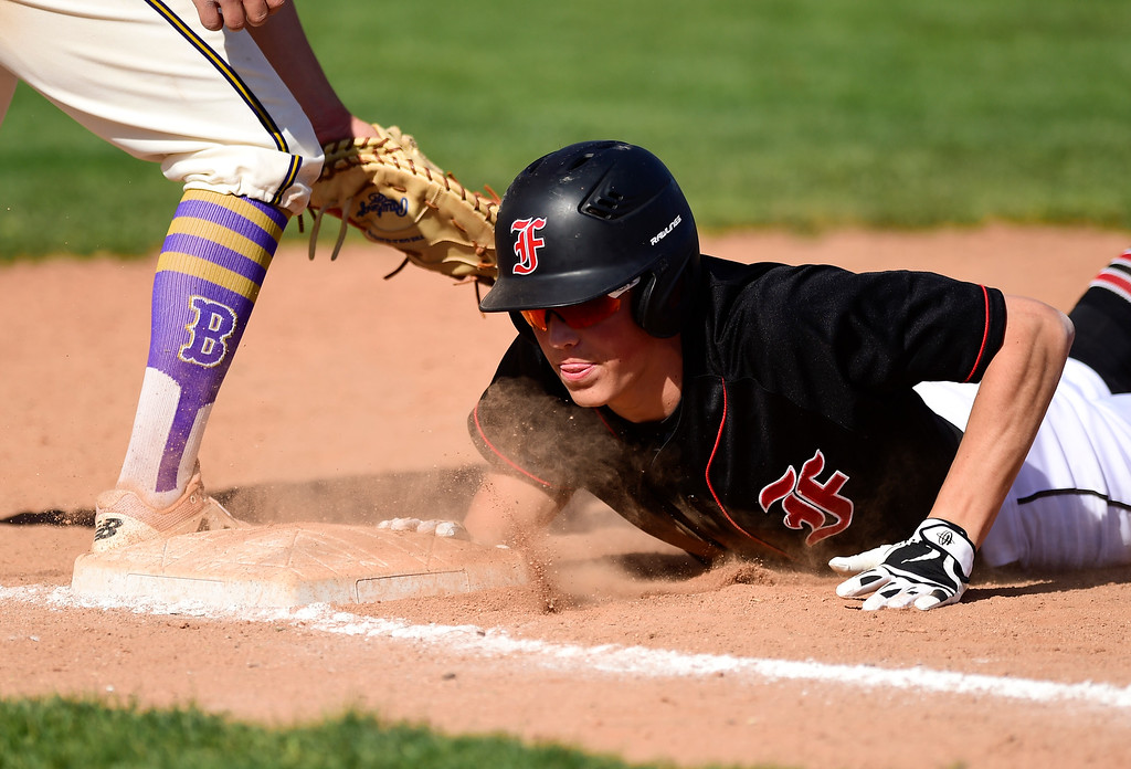 . BOULDER, CO - APRIL 25:Boulder High School\'s Nathan Bach tries to pick off Fairview High School\'s Greysen Carter (No. 23) at Scott Carpenter Park in Boulder on April 25, 2019. (Photo by Matthew Jonas/Staff Photographer)