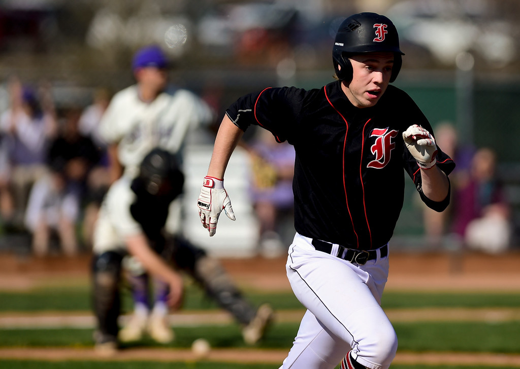 . BOULDER, CO - APRIL 25:Fairview High School\'s Hall Humphrey (No. 9) gets on base after a dropped ball by Boulder High School at Scott Carpenter Park in Boulder on April 25, 2019. (Photo by Matthew Jonas/Staff Photographer)