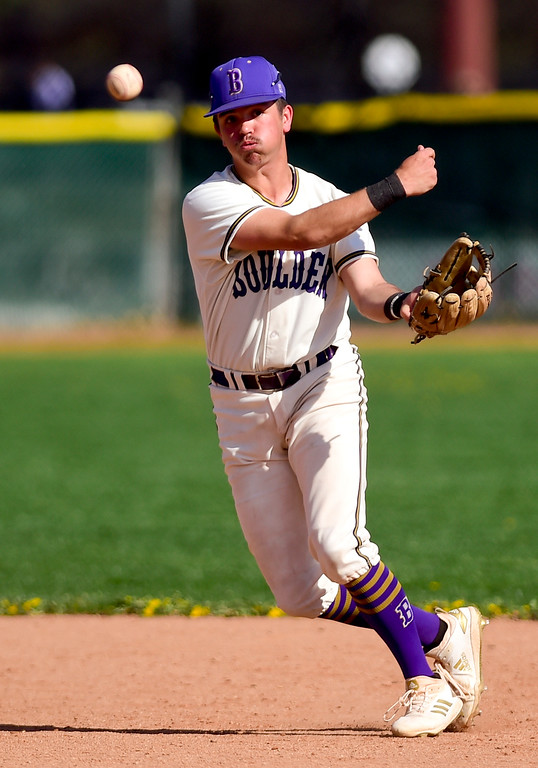. BOULDER, CO - APRIL 25:Boulder High School\'s Jackson Wyatt (No. 1) throws to first in the game against Fairview High School at Scott Carpenter Park in Boulder on April 25, 2019. (Photo by Matthew Jonas/Staff Photographer)