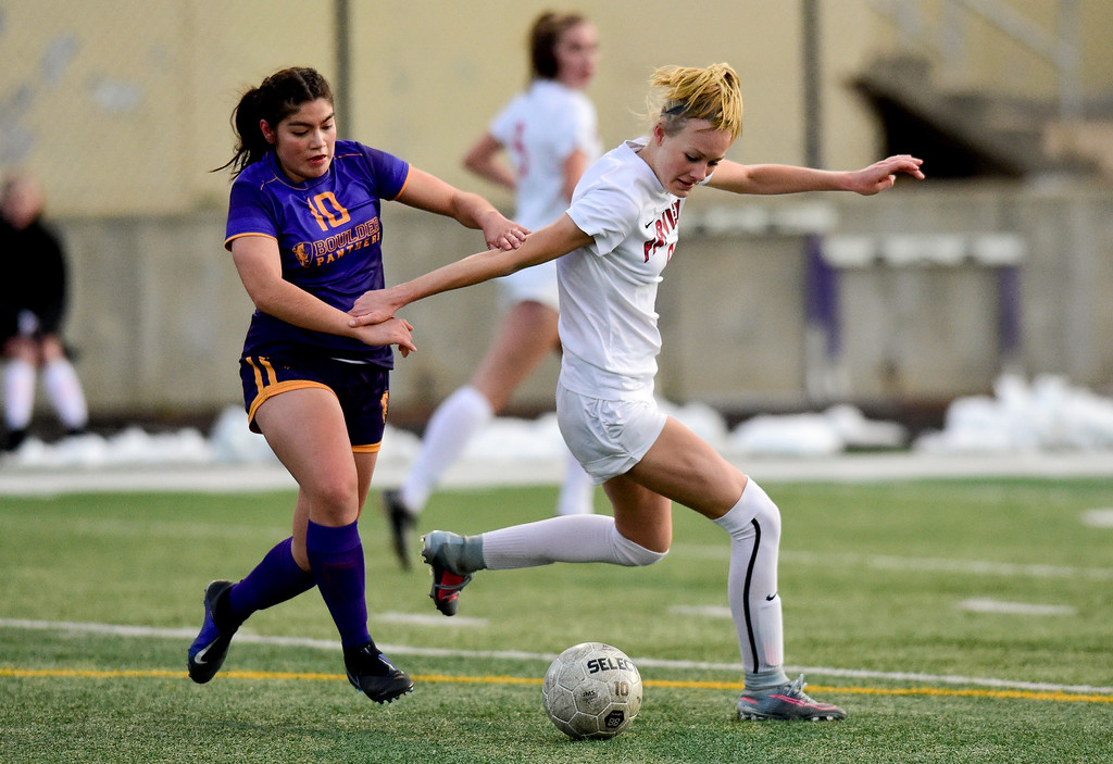 . BOULDER, CO - APRIL 11:Fairview High School\'s Blythe Sales (No. 9) and Boulder High School\'s Frida Aguilar (No. 10) battle for the ball at Recht Field in Boulder on April 11, 2019. (Photo by Matthew Jonas/Staff Photographer)