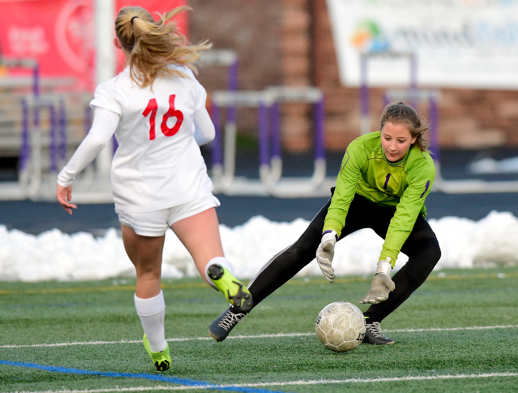. BOULDER, CO - APRIL 11:Boulder High School\'s Alex Smith (No. 1) makes a save while pressured by Fairview High School\'s Aspen Anderson (No. 16) at Recht Field in Boulder on April 11, 2019. (Photo by Matthew Jonas/Staff Photographer)