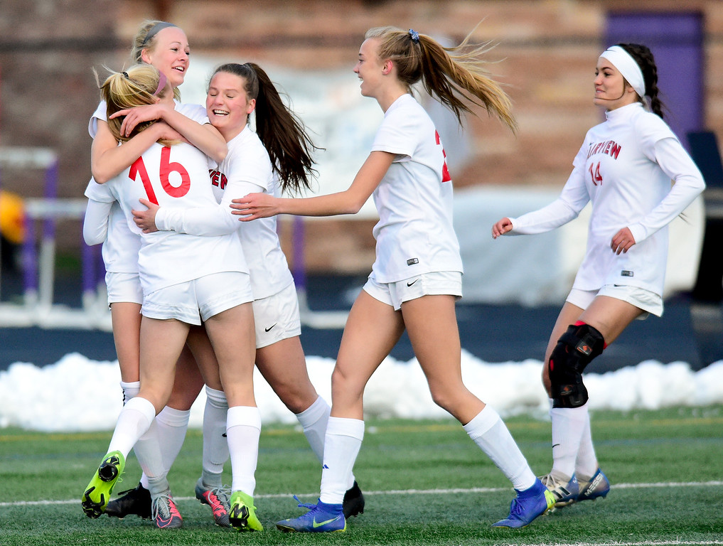 . BOULDER, CO - APRIL 11:Fairview High School\'s Blythe Sales (No. 9) celebrates a goal with teammates Aspen Anderson (No. 16) and Adriane Mason (No. 7) in the game against Boulder High School at Recht Field in Boulder on April 11, 2019. (Photo by Matthew Jonas/Staff Photographer)