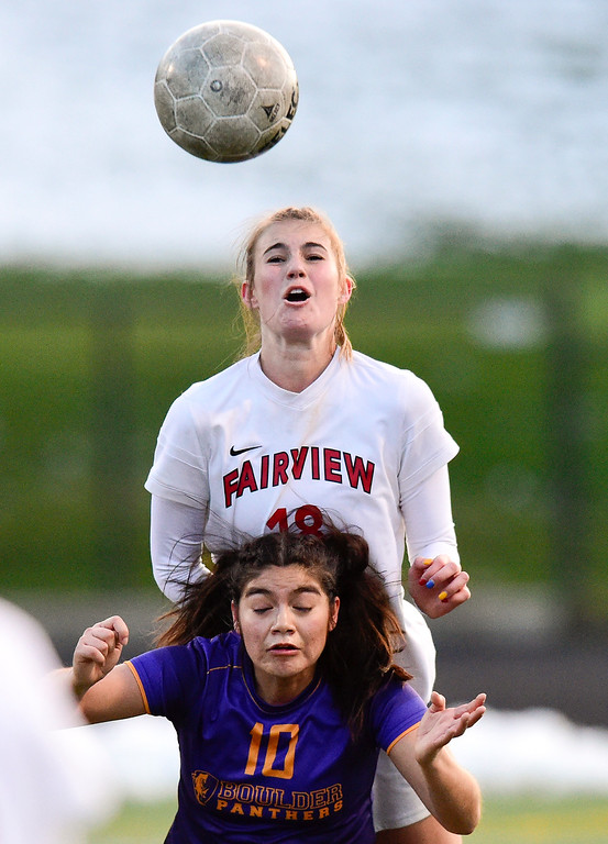 . BOULDER, CO - APRIL 11:Fairview High School\'s Kathryn Theodore (No.18) and Boulder High School\'s Frida Aguilar (No. 10) collide while trying to control the ball at Recht Field in Boulder on April 11, 2019. (Photo by Matthew Jonas/Staff Photographer)