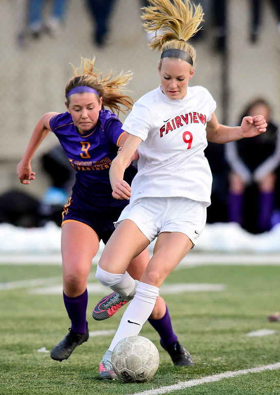 . BOULDER, CO - APRIL 11:Fairview High School\'s Blythe Sales (No. 9) battles for control of the ball with Boulder High School\'s Sara Reardon (No. 9) at Recht Field in Boulder on April 11, 2019. (Photo by Matthew Jonas/Staff Photographer)