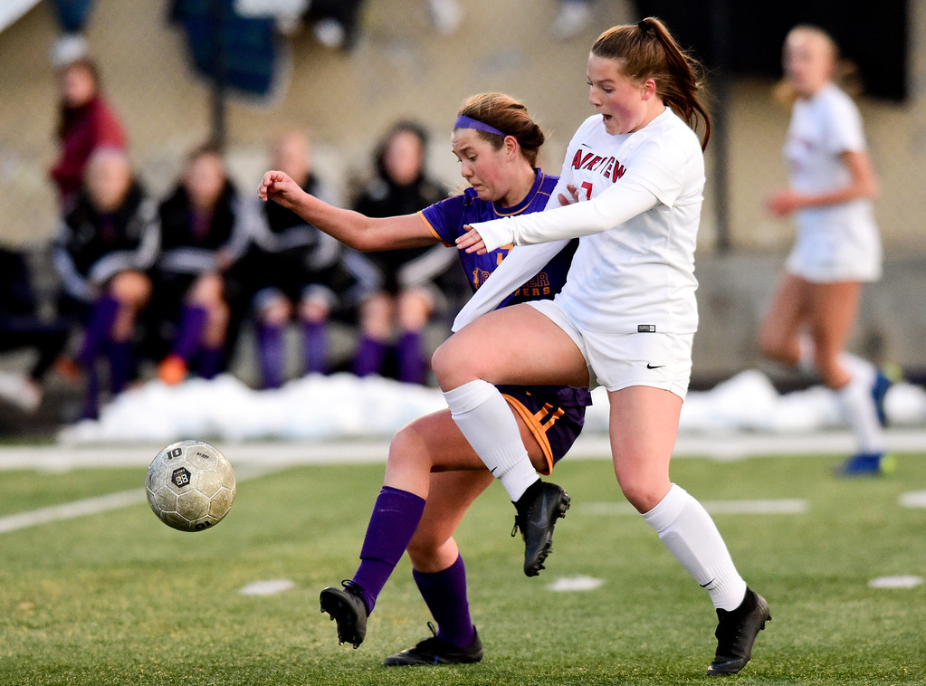 . BOULDER, CO - APRIL 11:Boulder High School\'s Sara Reardon (No. 9) and Fairview High School\'s Adriane Mason (No. 7) chase down the ball at Recht Field in Boulder on April 11, 2019. (Photo by Matthew Jonas/Staff Photographer)