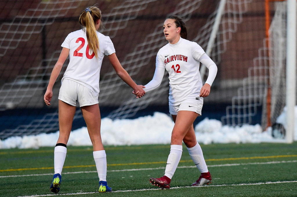 . BOULDER, CO - APRIL 11:Fairview High School\'s Georgia Weeks (No. 20) and Brooke Berdan (No. 12) celebrate a shot on goal in the game against Boulder High School at Recht Field in Boulder on April 11, 2019. (Photo by Matthew Jonas/Staff Photographer)