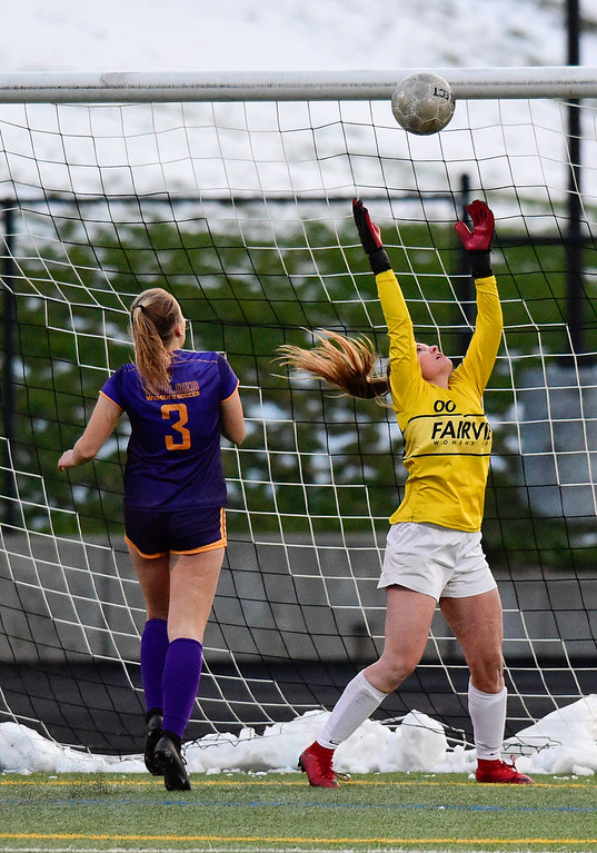 . BOULDER, CO - APRIL 11:Fairview High School\'s Hayden Velds (No. 00) makes a save while pressured by Boulder High School\'s Annie Studebaker (No. 3) at Recht Field in Boulder on April 11, 2019. (Photo by Matthew Jonas/Staff Photographer)