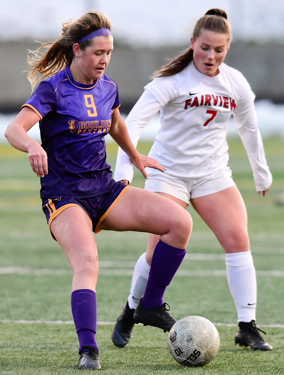 . BOULDER, CO - APRIL 11:Boulder High School\'s Sara Reardon (No. 9) controls the ball while pressured by Fairview High School\'s Adriane Mason (No. 7) at Recht Field in Boulder on April 11, 2019. (Photo by Matthew Jonas/Staff Photographer)