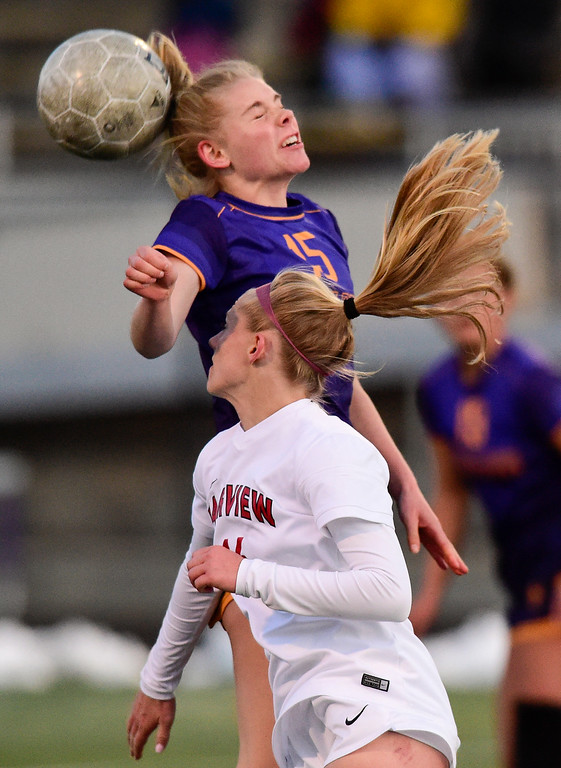 . BOULDER, CO - APRIL 11:Fairview High School\'s Aspen Anderson (No. 16) and Boulder High School\'s Eve Bleam (No. 15) collide while jumping for the ball at Recht Field in Boulder on April 11, 2019. (Photo by Matthew Jonas/Staff Photographer)
