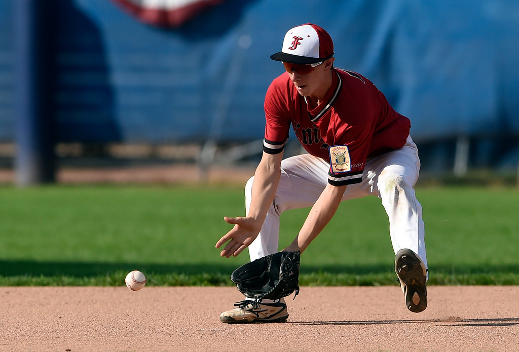 . Fairview\'s Luke Silverman makes a stop at short-stop for an out at first base during a game against Centaurus on Thursday at Centaurus High School in Lafayette. More photos: BoCoPreps.com Jeremy Papasso/ Staff Photographer 07/26/2018