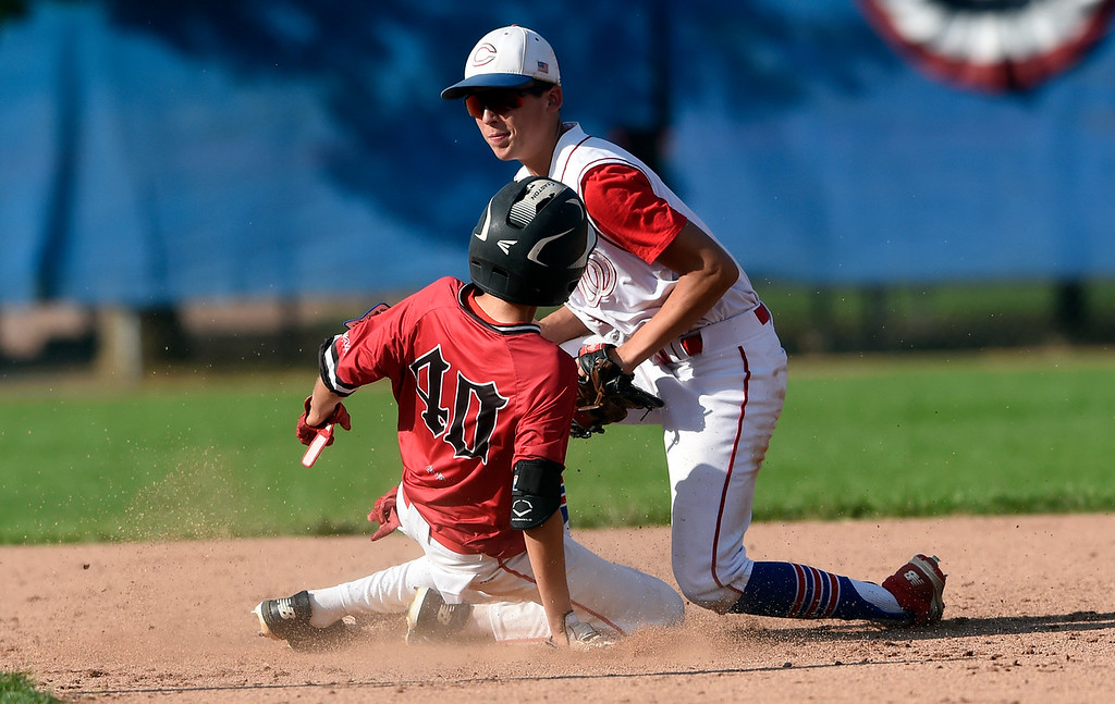 . Centaurus\'s Marcus Vanzee tags out Dillon Souvignier at second base during a game against Fairview on Thursday at Centaurus High School in Lafayette. More photos: BoCoPreps.com Jeremy Papasso/ Staff Photographer 07/26/2018