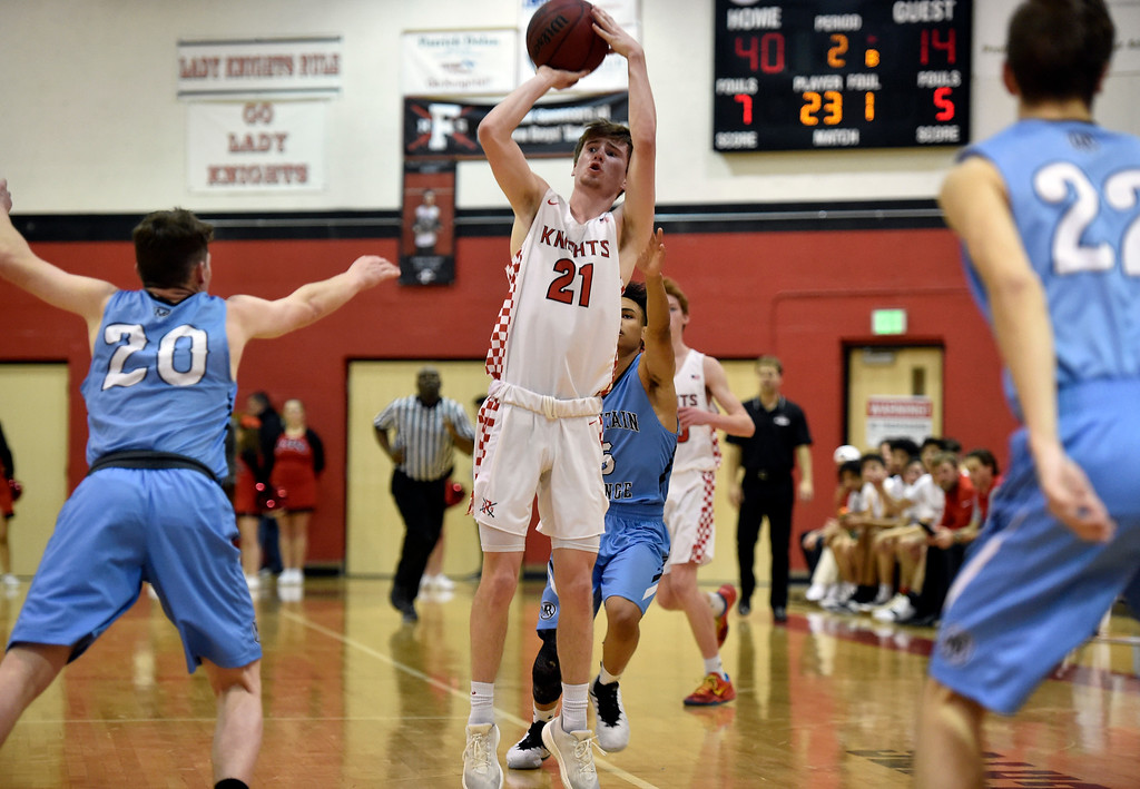 . BOULDER, CO - JANUARY 11, 2019: Fairview High School\'s Mark Dolan sinks a three-pointer during a CHSAA basketball game against Mountain Range on Friday in Boulder. More photos: BoCoPreps.com (Photo by Jeremy Papasso/Staff Photographer)