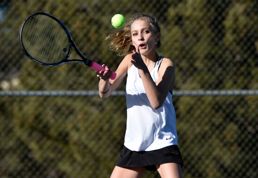 . BOULDER, CO - MARCH 20, 2019: Fairview High School\'s Josie Elowsky returns the ball during a #1 Doubles match against Niwot on Wednesday in Boulder. More photos: BoCoPreps.com (Photo by Jeremy Papasso/Staff Photographer)