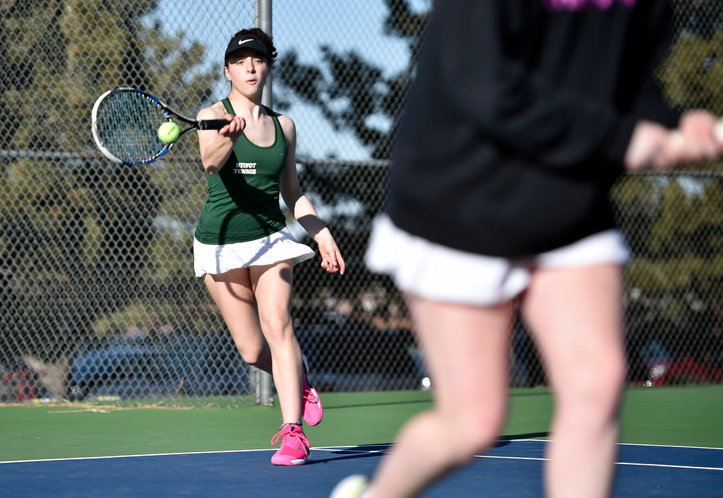 . BOULDER, CO - MARCH 20, 2019: Niwot High School\'s Maedee Trank-Greene returns the ball during a #2 Doubles match against Fairview on Wednesday in Boulder. More photos: BoCoPreps.com (Photo by Jeremy Papasso/Staff Photographer)