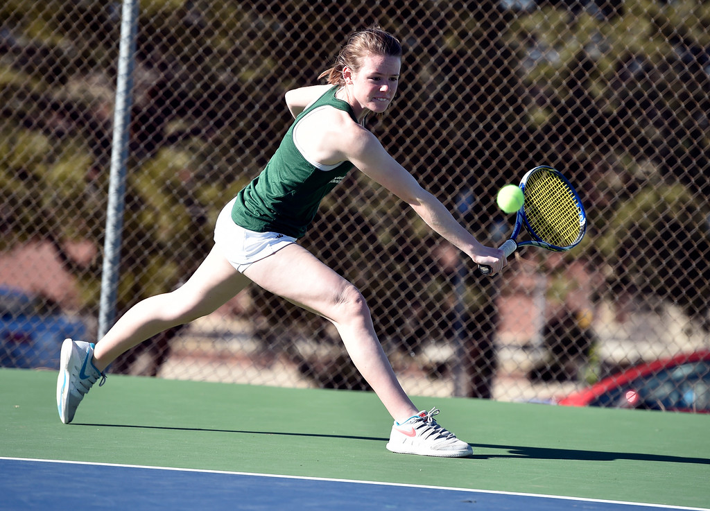 . BOULDER, CO - MARCH 20, 2019: Niwot High School\'s Tehnley White returns the ball during a match against Fairview\'s Alexis Bernthal on Wednesday in Boulder. More photos: BoCoPreps.com (Photo by Jeremy Papasso/Staff Photographer)