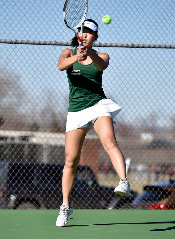 . BOULDER, CO - MARCH 20, 2019: Niwot High School\'s Lucy Lu serves the ball during a match against Fairview\'s Sophie Pearson on Wednesday in Boulder. More photos: BoCoPreps.com (Photo by Jeremy Papasso/Staff Photographer)
