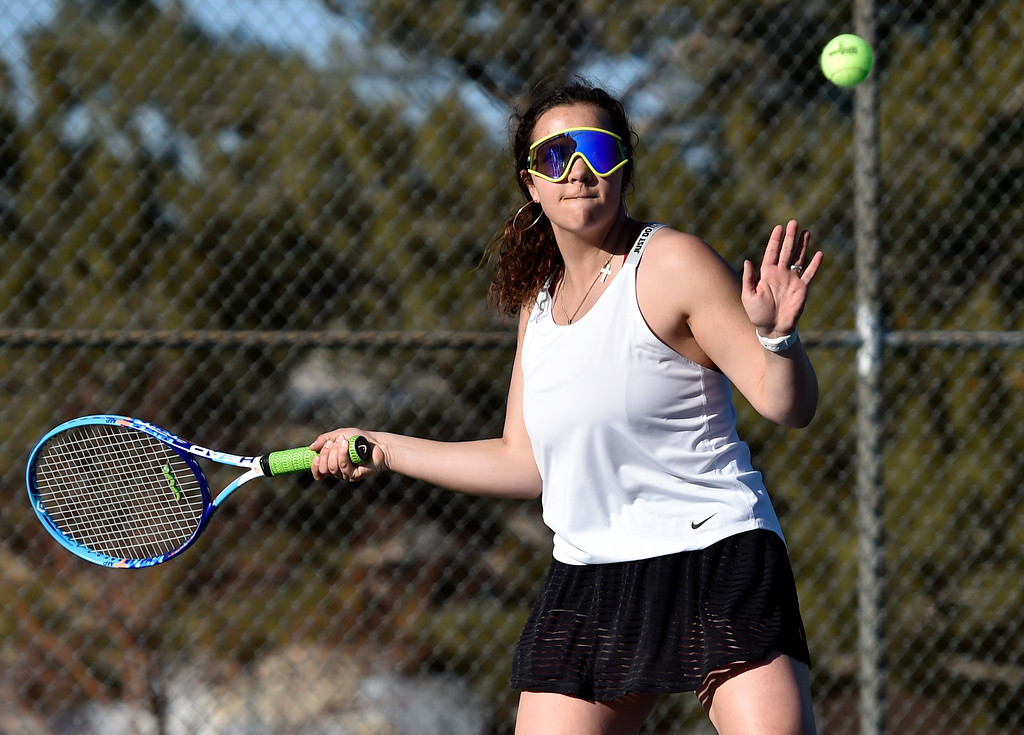 . BOULDER, CO - MARCH 20, 2019: Fairview High School\'s Ellen Bartells returns the ball during a #2 Doubles match against Niwot on Wednesday in Boulder. More photos: BoCoPreps.com (Photo by Jeremy Papasso/Staff Photographer)