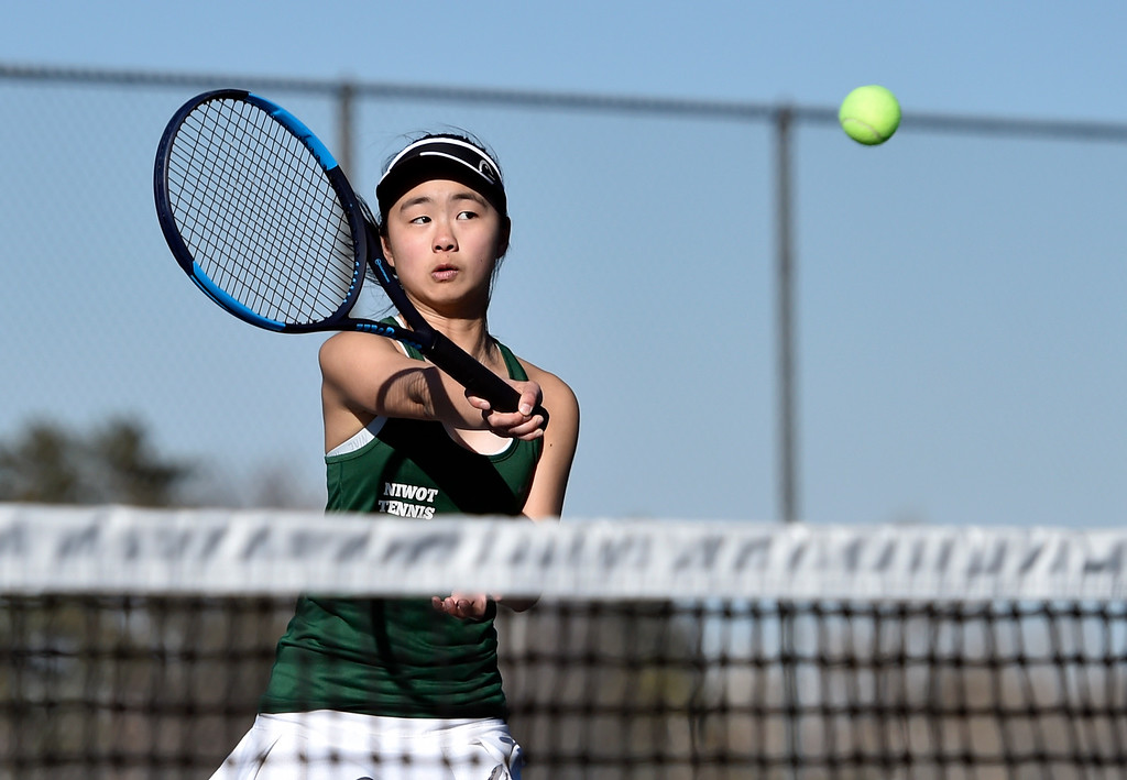 . BOULDER, CO - MARCH 20, 2019: Niwot High School\'s Catherine Xiao returns the ball during a #1 Doubles match against Fairview on Wednesday in Boulder. More photos: BoCoPreps.com (Photo by Jeremy Papasso/Staff Photographer)