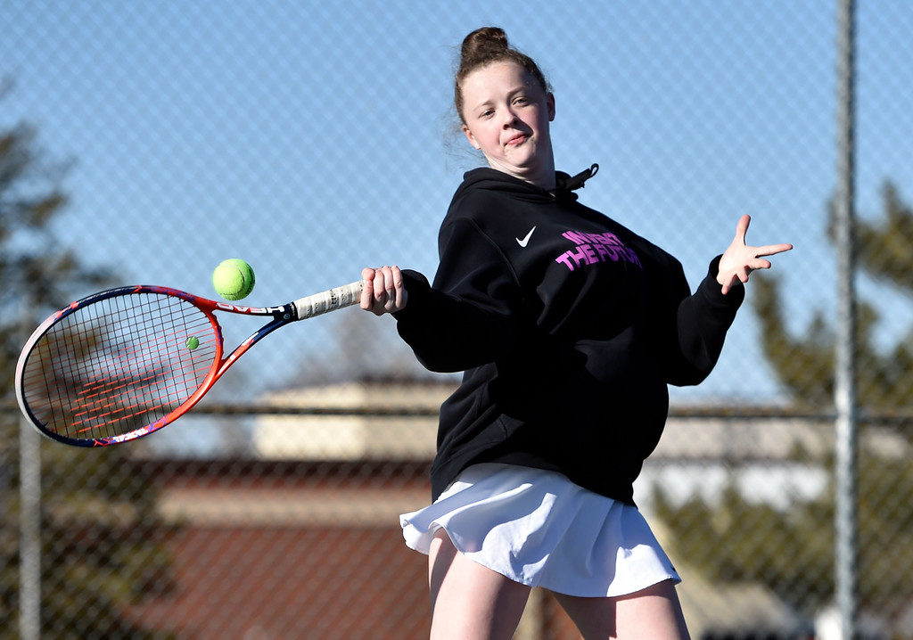 . BOULDER, CO - MARCH 20, 2019: Niwot High School\'s Lily Sieben returns the ball during a #2 Doubles match against Fairview\'s on Wednesday in Boulder. More photos: BoCoPreps.com (Photo by Jeremy Papasso/Staff Photographer)