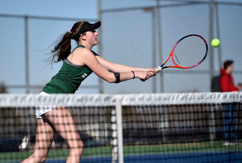 . BOULDER, CO - MARCH 20, 2019: Niwot High School\'s Annie Heinritz returns the ball during a #1 Doubles match against Fairview on Wednesday in Boulder. More photos: BoCoPreps.com (Photo by Jeremy Papasso/Staff Photographer)