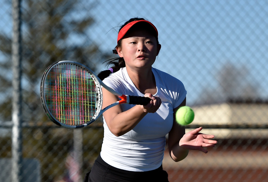 . BOULDER, CO - MARCH 20, 2019: Fairview High School\'s Ana Swanson returns the ball during a #2 Doubles match against Niwot on Wednesday in Boulder. More photos: BoCoPreps.com (Photo by Jeremy Papasso/Staff Photographer)
