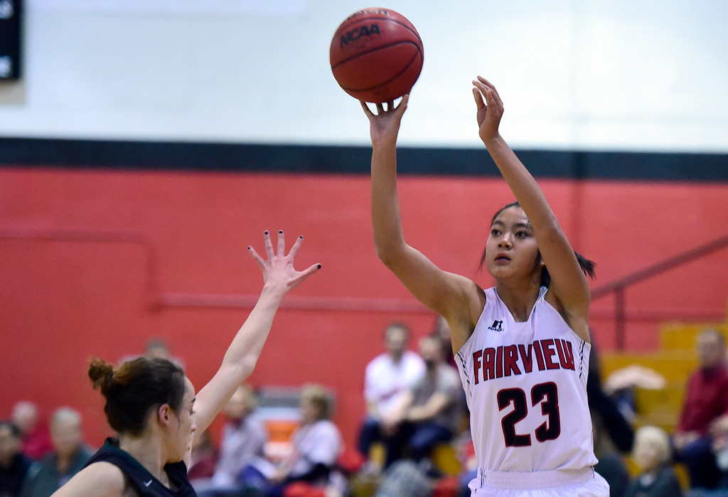 . Fairview High School\'s Ashley Panem sinks a three-pointer during a playoff game against Pine Creek on Friday in Boulder. More photos at dailycamera.com Jeremy Papasso/ Staff Photographer 02/23/2018
